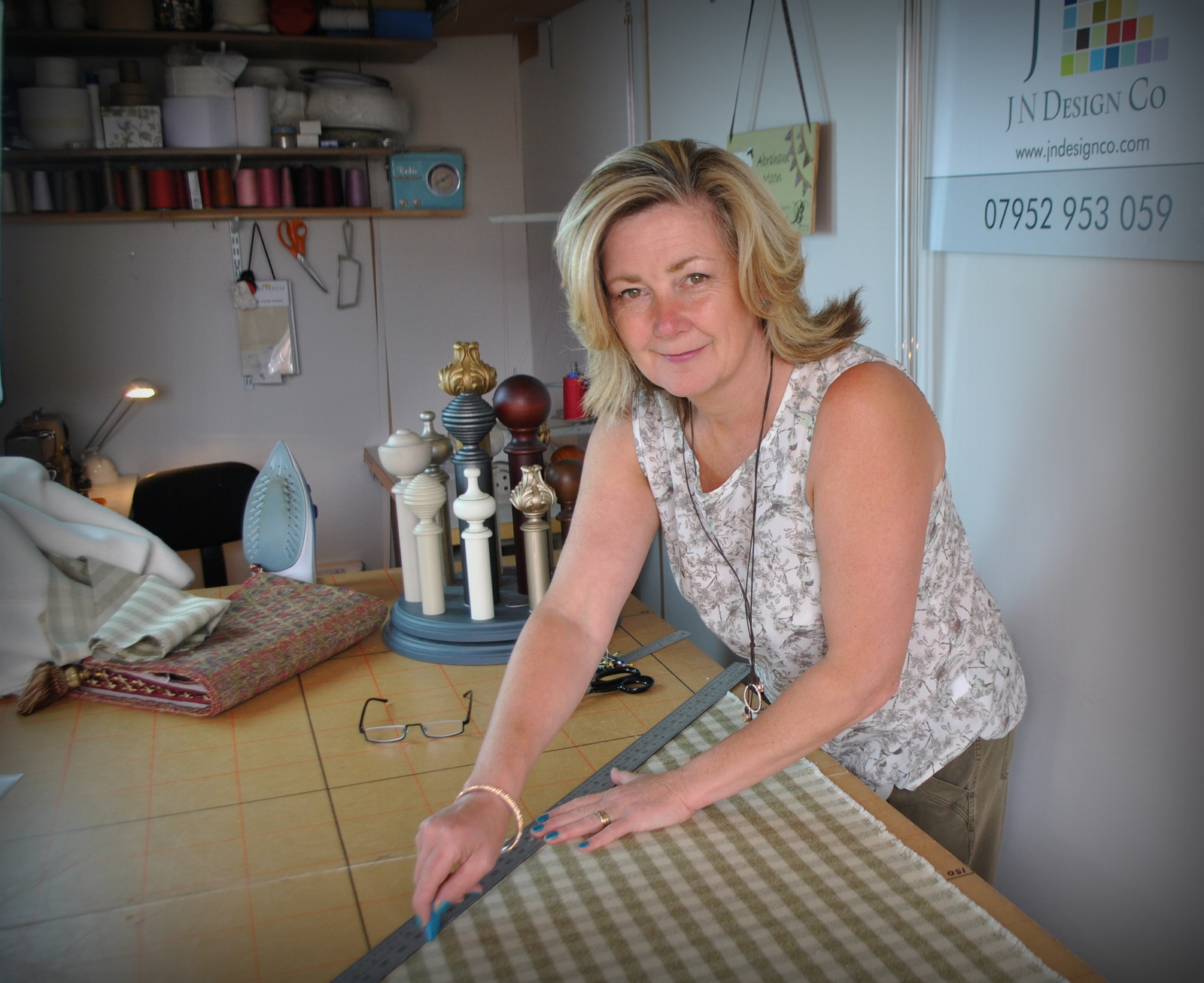 Jo Naylor cutting material to size in her workshop